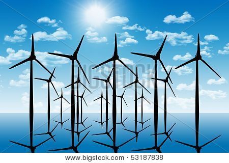 Group Of Aeolian Windmills In Perspective Silhouette Above The Water