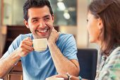 picture of canteen  - Two laughing students having a cup of coffee in college canteen - JPG