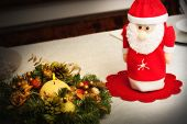 stock photo of centerpiece  - Christmas centerpiece with candle and bottle as Santa Claus - JPG