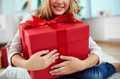 Close-up of girl holding big red giftbox