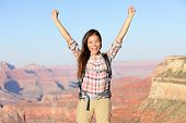 image of grand canyon  - Happy winner hiker in Grand Canyon cheering with arms raised up in winning gesture enjoying the beautiful landscape - JPG