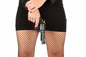 picture of fishnet stockings  - Legs of dangerous woman with handgun and black shoes fishnet stockings - JPG