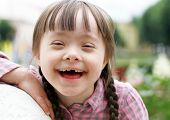 foto of playtime  - Portrait of beautiful young girl smiling outside - JPG