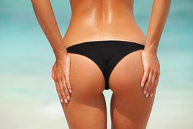 picture of bum  - Sexy woman buttocks on the beach background - JPG