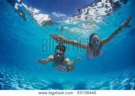 Young couple underwater in the swimming pool