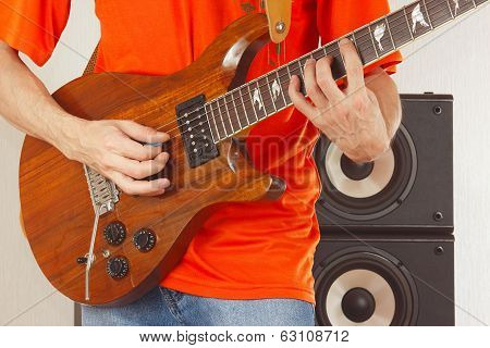 Posing hands of musician playing the guitar