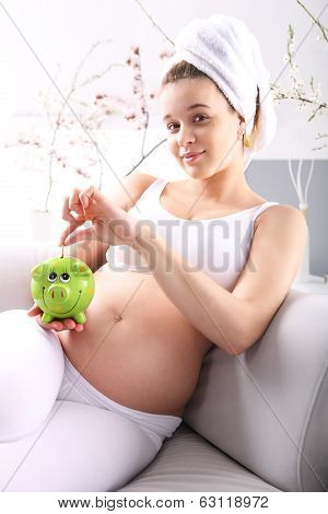 Pregnant with piggy bank