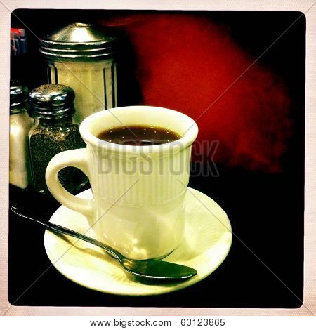 Instagram style image of coffee served in a diner