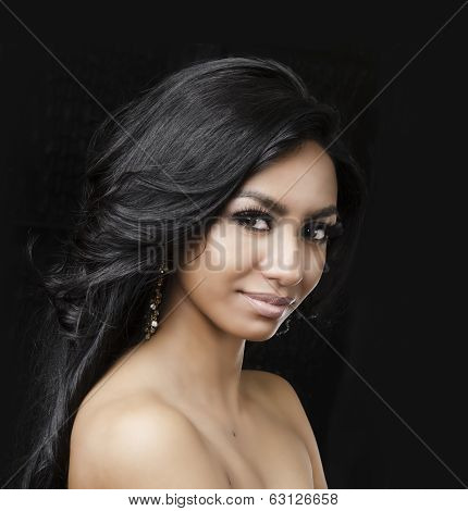Beautiful young exotic woman with long dark hair