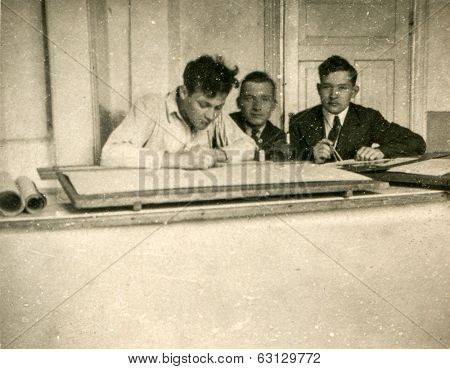 LODZ, POLAND, CIRCA 1950's: Vintage photo of three draftsmen working