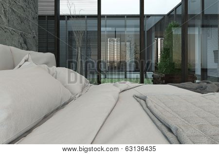 Closeup of bed with white bedsheets