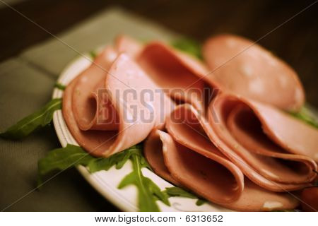 mortadella salami  on bed of rocket salad