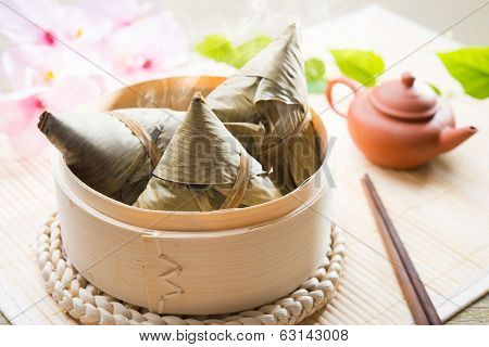 Asian Chinese rice dumplings or zongzi with tea
