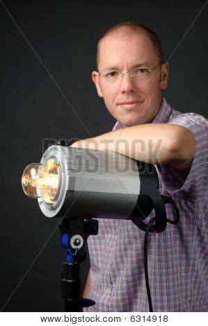 Photographer With Studio Flash
