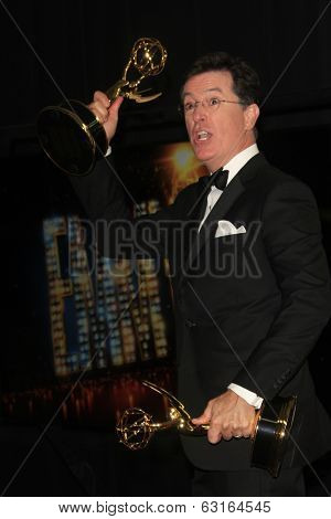 LOS ANGELES - SEP 22: Stephen Colbert in the press room during the 65th Annual Primetime Emmy Awards held at Nokia Theater L.A. Live on September 22, 2013 in Los Angeles, California