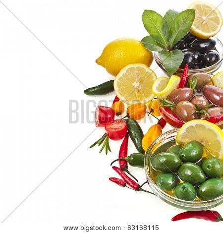 Border heap of olives dish with vegetables, herbs, spices isolated on a white background