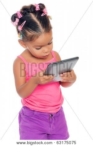 Multiracial small girl using a modern tablet computer (isolated on white)