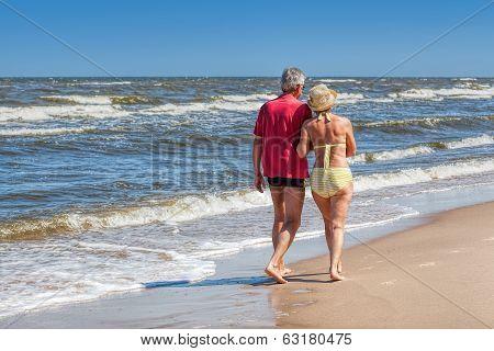 Couple Strolling At Coastline