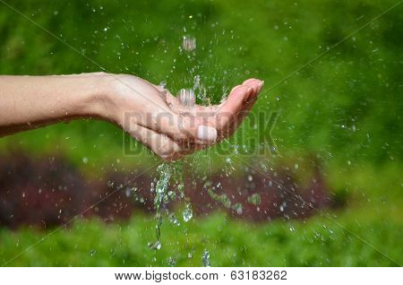 Woman's Hand With Water Splash
