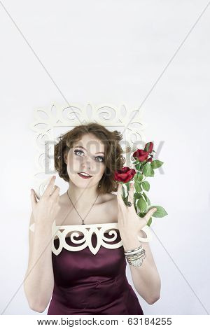 Woman posing with picture frame