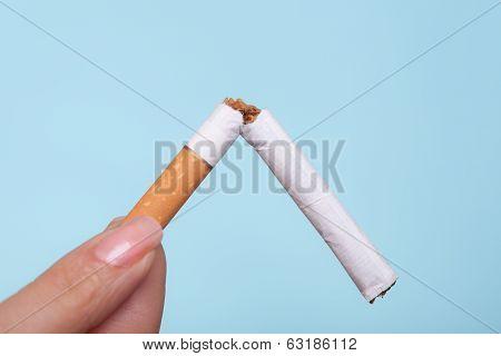 Addiction. Broken Cigarette In Hand. Quit Smoking