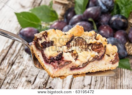 Plum Cake With Fruits In The Background