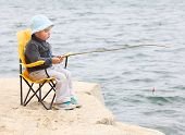 Little boy catching fish.