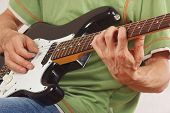 Guitarist put fingers for chords on electric guitar