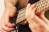 picture of fret  - Hands of musician playing the electric bass guitar closeup - JPG