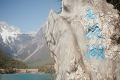 foto of jade blue  - Stone Label Is Blue Moon Valley In Lijiang,yunnan, China. ** Note: Shallow depth of field - JPG