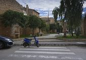 picture of vespa  - Blue scooter on pedestrian crossing in Mallorca Balearic islands Spain - JPG