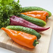 Fresh vegetables for salad: cucumber, tomato, sweet pepper