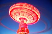 foto of swinger  - This is a long exposure of a rotating swing called the  - JPG
