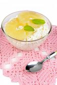 Bowl of tasty cottage cheese with pineapple, isolated on white