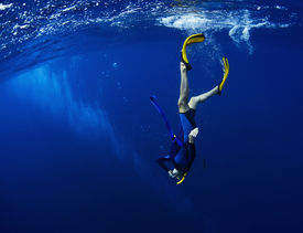 pic of bottomless  - Free diver performing equalization at the beginning of the dive - JPG