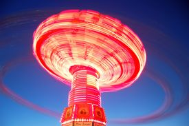 pic of swingers  - This is a long exposure of a rotating swing called the  - JPG