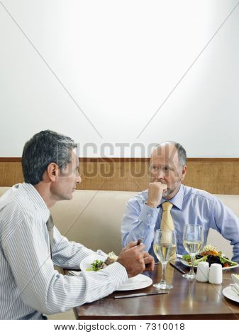 Businessmen dining in restaurant