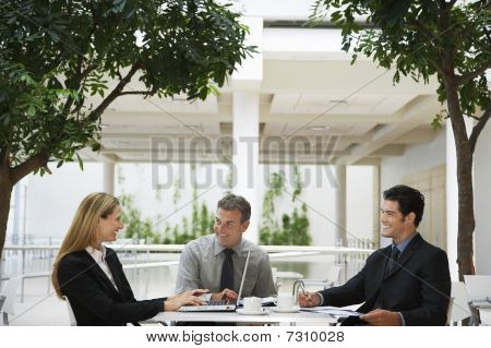 Three businesspeople working outdoors