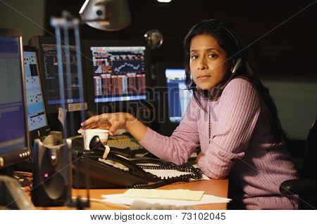 Middle aged businesswoman posing for the camera at her desk