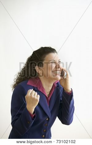 Woman talking on the phone laughing