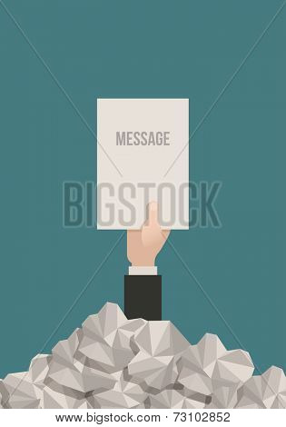 Businessman hand reaches out from a pile of paperwork with a message.