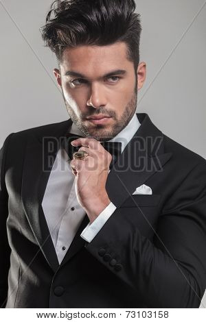 Close up picture of an attractive young man thinking and looking away.