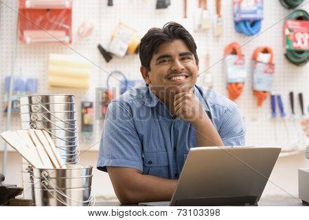 Male employee using a laptop
