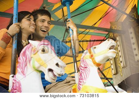 Couple riding a rollercoaster