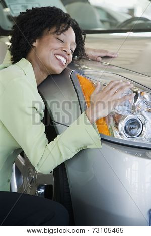 Woman hugging her car