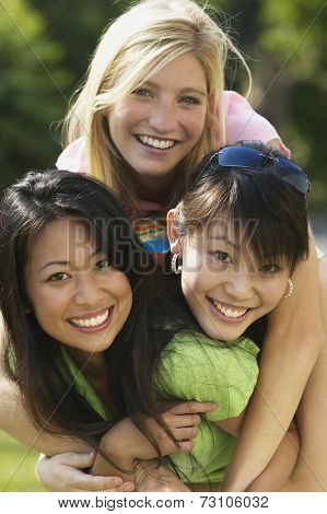 Young women smiling together