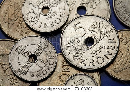 Coins of Norway. Monogram of King Harald V depicted in Norwegian one krone coin and Norwegian five kroner coin.