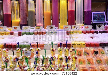BARCELONA - AUGUST 8: A lot of fruit mousses on a market stall in the Mercat de Sant Josep de la Boqueria in one of the oldest markets in Europe on 8 August 2014 in Barcelona, Spain.