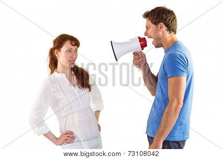 Man shouting through a megaphone at woman on white background