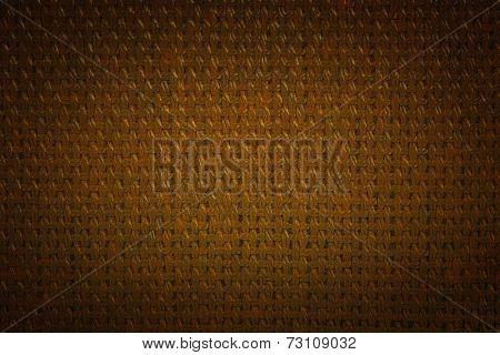 Coarse gold color fabric with a dark vignette.